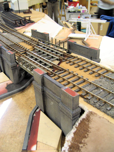Canal bridge under construction.  A lifting bridge is also under construction at the rear of the layout and the water is yet to be coloured