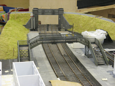 Initial colouring applied to the grass and footbridge